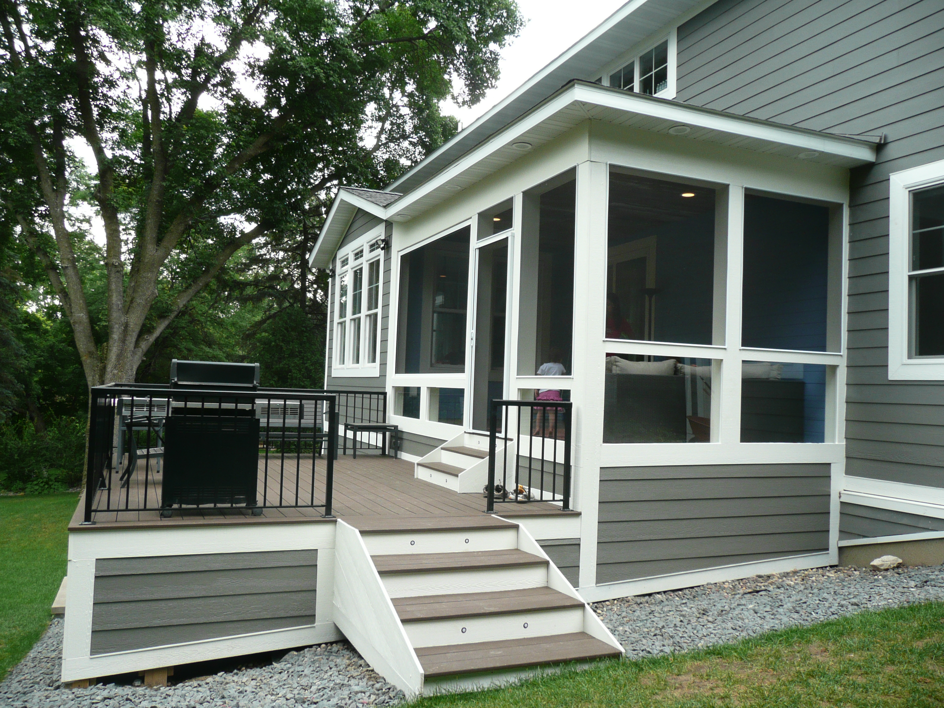 Screen porch and deck combination.